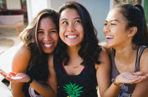 A group of young girls happily smiling as they enjoy their time with each other