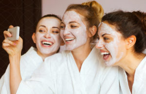 A group of three girls taking a selfie as they enjoy a teenace detoxifying facial