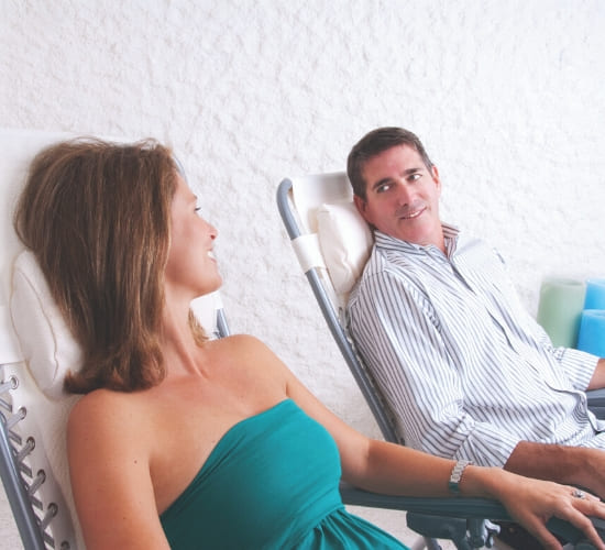 A couple enjoying the relaxation room at the salt room orlando